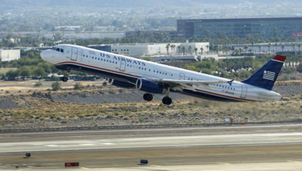 A US Airways plane takes off.