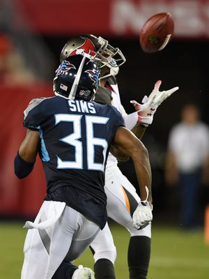 Buccaneers wide receiver DeSean Jackson (11) pulls in a catch over Titans cornerback LeShaun Sims (36) in a preseason game earlier this year.