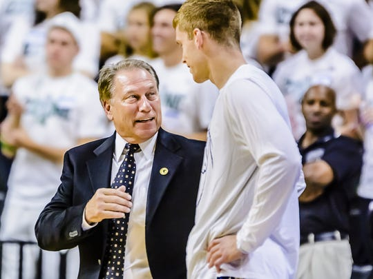 MSU coach Tom Izzo speaks with former player Russell Byrd prior to the Spartans' game with The Master's College on Nov. 3 at Breslin Center in East Lansing. Byrd transferred from MSU at the end of last season, but still feels connected to his former coach and teammates during their Final Four run. KEVIN W. FOWLER PHOTO