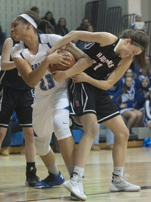 Sterling's Jordan Wallace, battles for the ball against Haddonfield's C.C. Mooney, 31, at the top of the first quarter at Sterling.