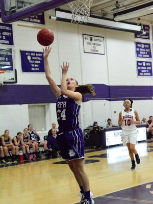 Rumson-Fair Haven's Stephanie Lesko (24) takes a shot during Sunday's game against Saddle River in the Bulldog Classic.