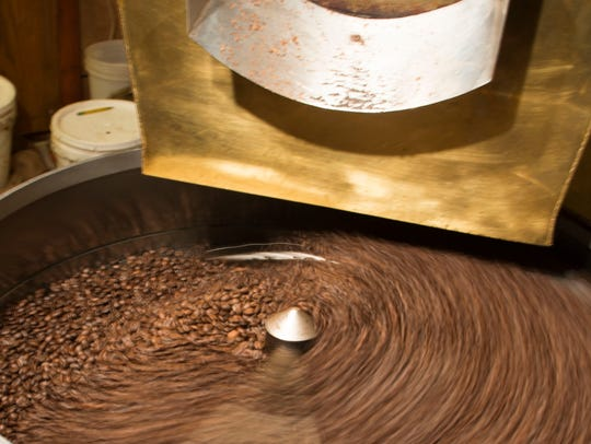 Fresh-roasted coffee beans from Honduras spin after