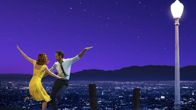 """Emma Stone and Ryan Gosling as depicted on a poster for """"La La Land."""""""