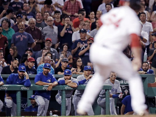 Toronto Blue Jays players watch Boston Red Sox relief pitcher Ben Taylor deliver during the ninth inning of a baseball game at Fenway Park in Boston, Wednesday, July 19, 2017. The Red Sox defeated the Blue Jays 5-1. (AP Photo/Charles Krupa)