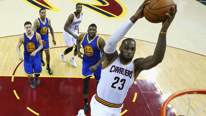 LeBron James dunks the ball during the second half against the Warriors in Game 6 of the 2016 NBA Finals at Quicken Loans Arena Thursday in Cleveland.