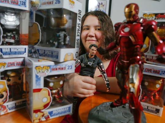 "Megan Welsh of Stanton, a collector of Iron Man comics, figures and other memorabilia, is awaiting the release of the movie ""Captain America: Civil War,"" which features the ironbound Tony Stark. She's pictured at her Stanton apartment Saturday."
