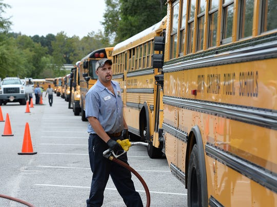Greenville County Schools buses are fueled up and checked after arriving at the North Charleston Coliseum in preparation for Hurricane Matthew evacuations of Charleston residents.