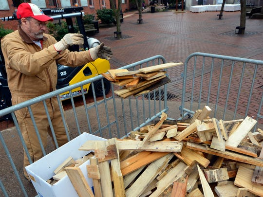 Volunteer Ed Gallagher helps unload firewood for this weekend's FestivICE event on Cherry Lane, Thursday, January 12, 2017. The event features live ice sculpting, music, fire pits and marshmallows, frozen turkey bowling and more from 9a.m.-3p.m. on Cherry Lane and N. Beaver St. John A. Pavoncello photo