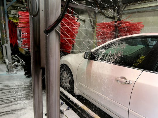 A vehicle goes through the Mister B's Express Wash