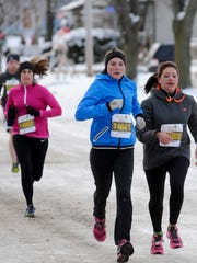 Tanya Thompson of Maribel, center, Cassandra Schoepp of Manitowoc, right, and Jessica Hanson of Manitowoc, back, head for the 5k finish line in the 7th annual Festival Foods Turkey Trot at Red Arrow Park in 2014.