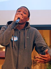 Kewan Crews, 16, from South Division High School, performs