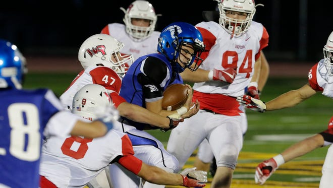 Oshkosh West's Ben Kohl runs the ball for a gain in the second quarter against Wisconsin Rapids on Friday.