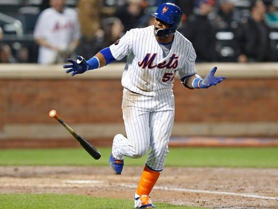 New York Mets' Yoenis Cespedes looks toward the Mets'