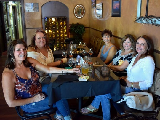 Customers enjoy the new extended happy hour at the Vintage in downtown Redding.