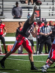 Riley Neal makes a pass during Ball State's Spring