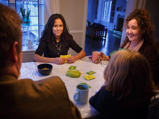 Jennifer Galdames, 17, plays a card game with Thomas