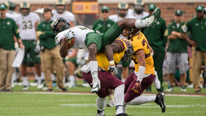 Michael Gallup, a junior-college transfer who is CSU's leading receiver this season, is upended by two Minnesota defenders after making a catch Saturday in the Rams' 31-24 loss to Gophers in Minneapolis.