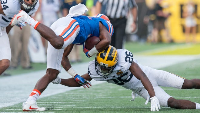 Michigan's season-opening game against Florida on Sept. 2 in Arlington, Texas, will kick off at 3:30 p.m. on ABC.