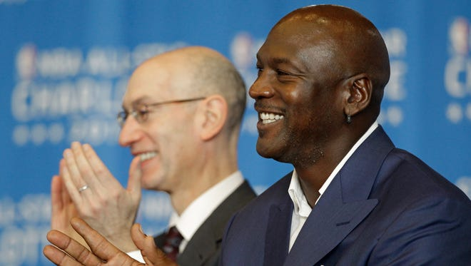 Charlotte Hornets owner Michael Jordan, right, has sent out a statement in support of NBA commissioner Adam Silver, left,