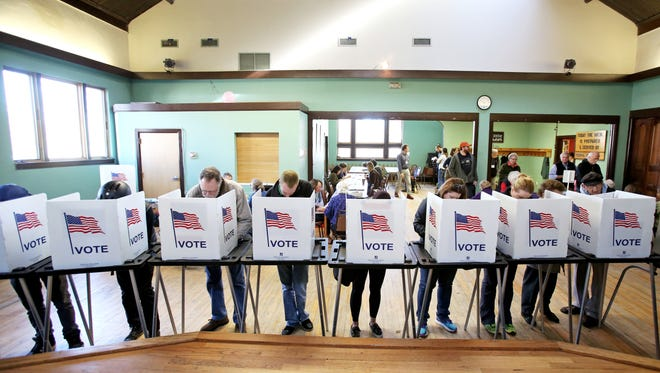 Voters in Madison, Wisconsin, cast ballots in last November's elections. The Supreme Court will hear a case Tuesday challenging the way the state's legislative districts were drawn by Republicans for partisan advantage.