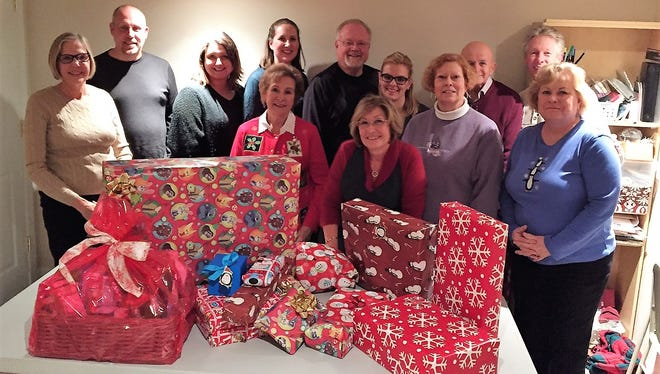 The Kensington Valley Civitan Club held a Christmas party that included wrapping gifts for a local family with three children adopted by the club.
