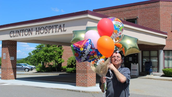Frank Guidi celebrates his work anniversary at Clinton Hospital with balloons and flowers, brought by his family members.