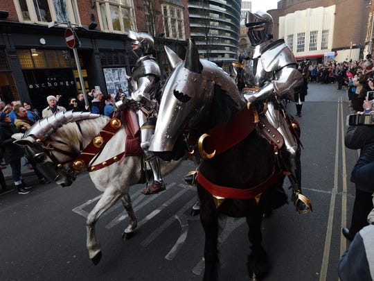 Knights in armour lead King Richard's coffin through the city towards Leicester Cathedral, in Leicester on March 22, 2015.