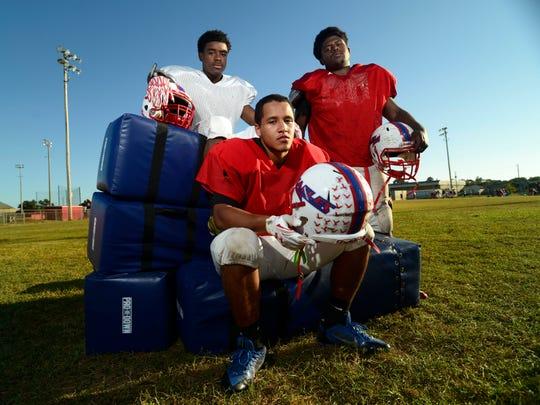 Pine Forest High School football players, from left, Ladarius Wiggins, Devante Wiggins and Angelo Garay.