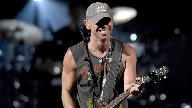 Kenny Chesney performs onstage during Kenny Chesney's The Big Revival 2015 Tour kick-off  at the Bridgestone Arena  in Nashville on March 26, 2015.