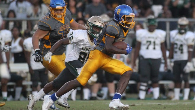 Rickards' Ferante Cowart hauls in a catch and turns upfield for a 75-yard touchdown against Lincoln.