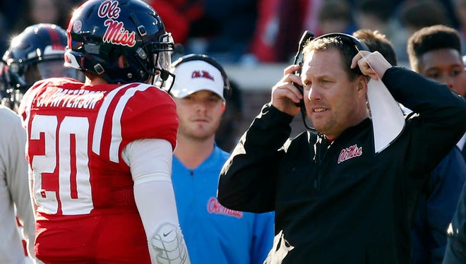 Ole Miss coach Hugh Freeze and quarterback Shea Patterson (20) began their offseason on Sunday.