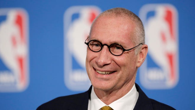 """FILE - In this Oct. 6, 2014, file photo, ESPN President John Skipper smiles during a news conference in New York. The former president of ESPN says he resigned from the sports network after an extortion plot by his cocaine dealer. John Skipper told the Hollywood Reporter on Thursday, March 15, 2018, """"they threatened me."""" Skipper says he understood the threat put himself, his family and his professional life at risk. (AP Photo/Mark Lennihan, File)"""
