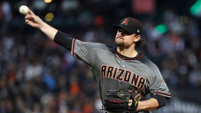 Arizona Diamondbacks starting pitcher Zack Godley throws to the San Francisco Giants during the first inning of a baseball game Monday, April 9, 2018, in San Francisco.