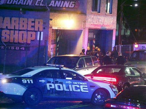 Police gather at the scene of a multiple shooting at Rockie's barber shop in Detroit on Wednesday, Nov. 6, 2013.