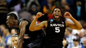 Xavier Musketeers guard Malcolm Bernard (left) and guard Trevon Bluiett (5) celebrate after defeating the Arizona Wildcats during the semifinals of the West Regional of the 2017 NCAA Tournament at SAP Center.