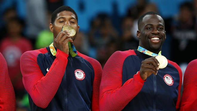 Paul George, left, and Draymond Green stand on the podium with gold medals after defeating Serbia during the Men's Gold medal game on Day 16 of the Rio 2016 Olympic Games at Carioca Arena 1 on August 21, 2016 in Rio de Janeiro, Brazil.