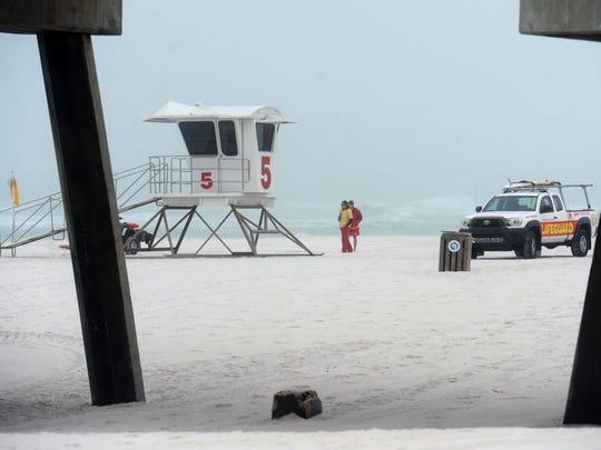 Lifeguards patrol Pensacola Beach Sunday to start off the new season.