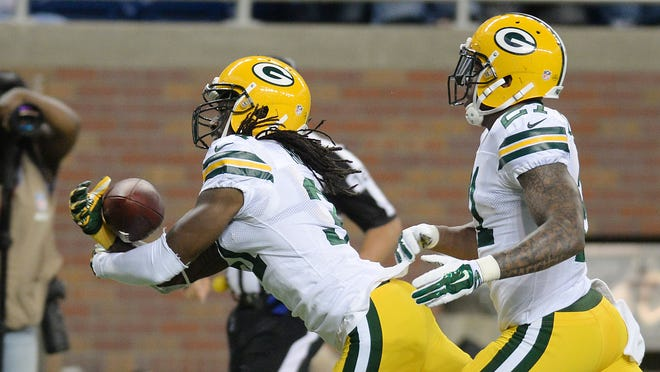 Green Bay Packers cornerback Davon House (31) makes an interception against the Detroit Lions at Ford Field.
