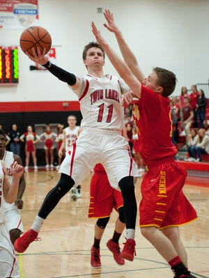 Sectional basketball - Twin Lakes vs Andrean.  Justin Crabb.  By Jerry Schultheiss for Journal & Courier.