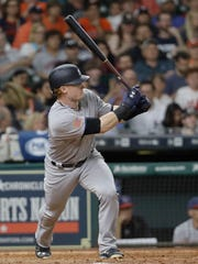 New York Yankees' Clint Frazier watches his home run