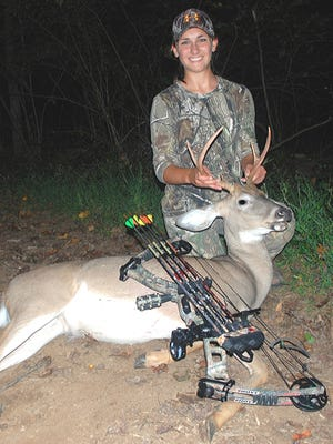 Jesse Winand with her first bow-killed buck, September 2014.