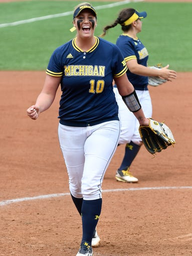 Michigan pitcher Sara Driesenga celebrates the last
