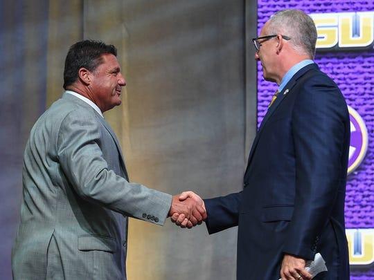 LSU Tigers head coach Ed Orgeron (left) shakes hands