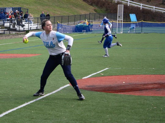 Immaculate Heart Academy junior P Ryleigh White fires to first base after fielding a bunt by Donovan Catholic in the second inning.