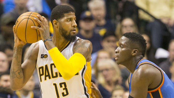 Paul George of Indiana, is defended by Victor Oladipo, second half, Oklahoma City Thunder at Indiana Pacers, Bankers Life Fieldhouse, Indianapolis, Monday, February 6, 2017. Indiana won 93-90.