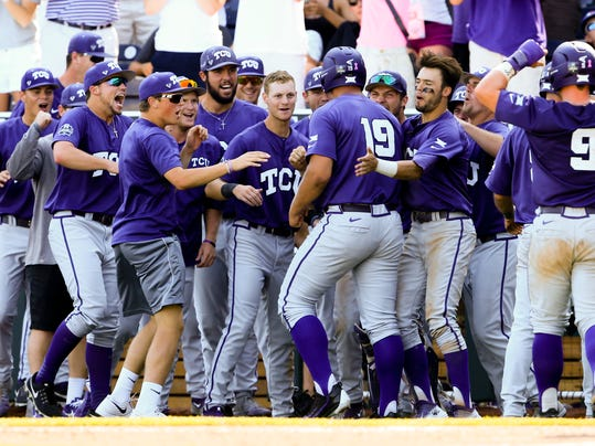 FILE - In this June 19, 2016, file photo, teammates celebrate withTCU's Luken Baker (19) after he hit a three-run home run against Texas Tech during the ninth inning of an NCAA men's College World Series baseball game in Omaha, Neb. TCU has made it to the College World Series three straight years, and the Horned Frogs have brought back eight everyday players, their top two starting pitchers and the closer. They'll open the season next Friday No. 1 in every major national poll. (AP Photo/Nati Harnik, file)