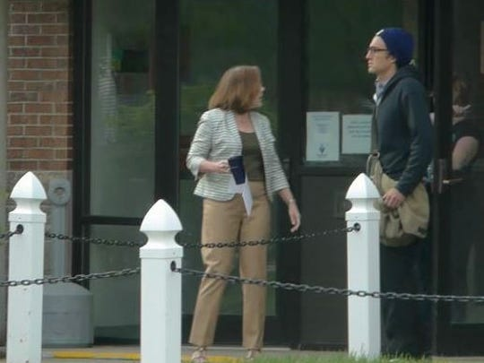 A man sought by South Burlington Police appears, right, in this photograph taken at the May 27 protest at Vermont Gas Systems in South Burlington.