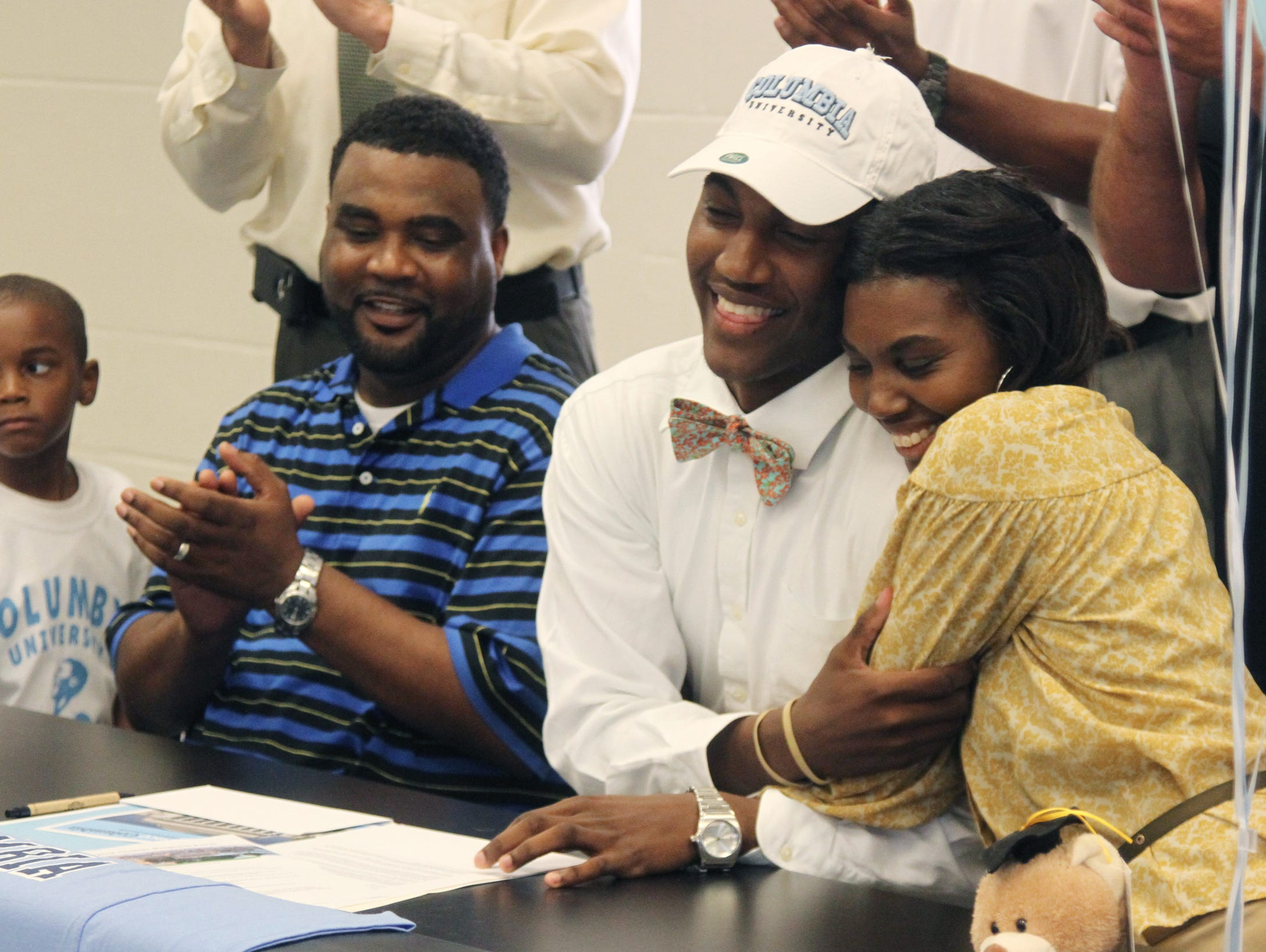 Mariner senior Rodney Hunter, who signed his NLI to Columbia on Wednesday, hugged his mother, Joy.
