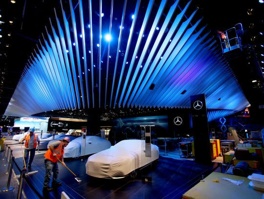 Mercedes-Benz vehicles sit under wraps as work continues