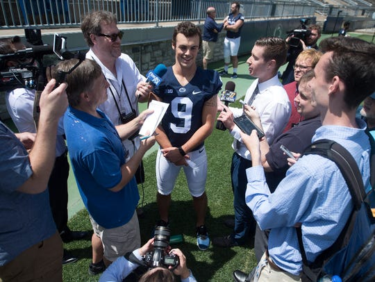 Penn State QB Trace McSorley is surrounded by the press